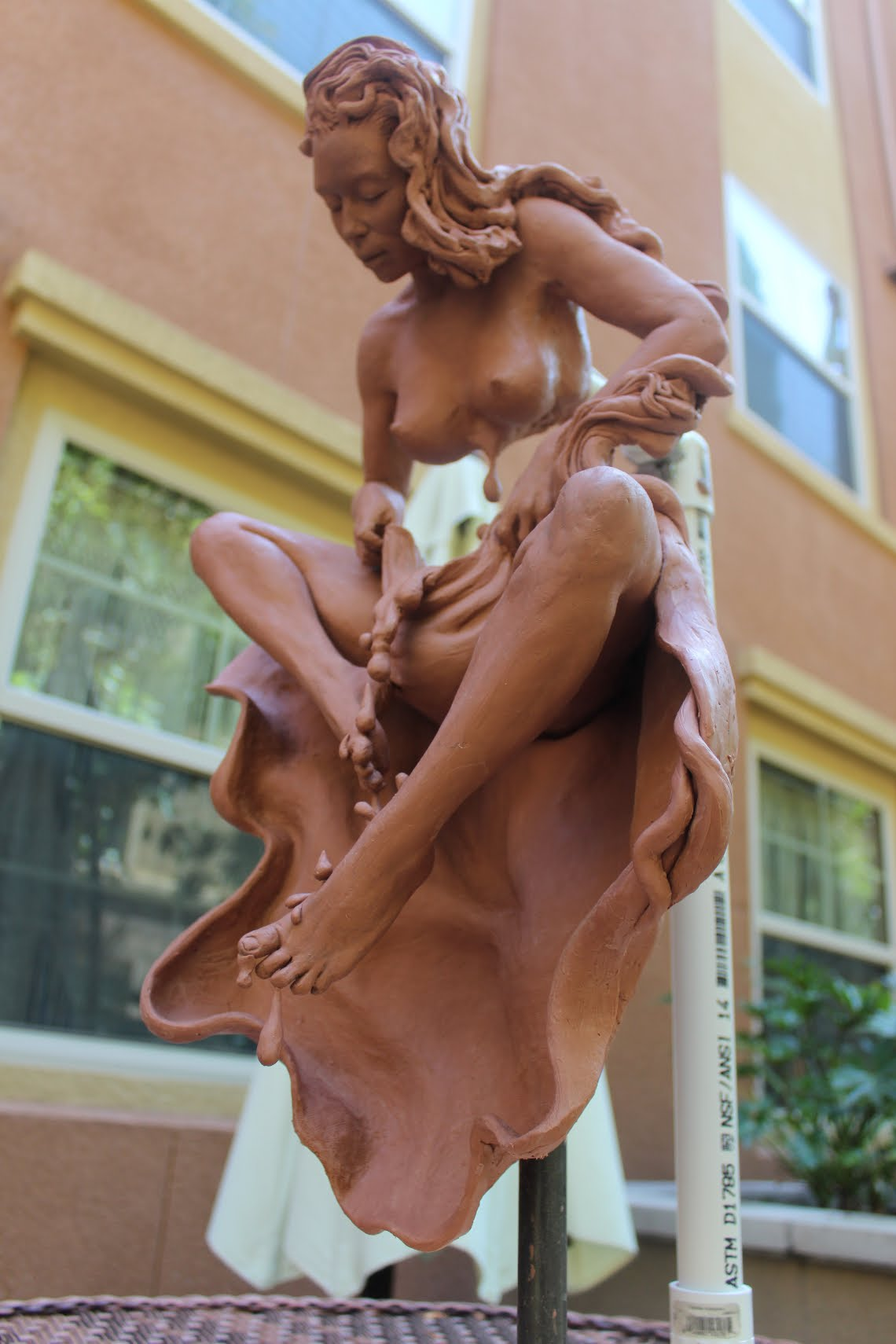 Figurative sculpture at an angle by Suzanne Head