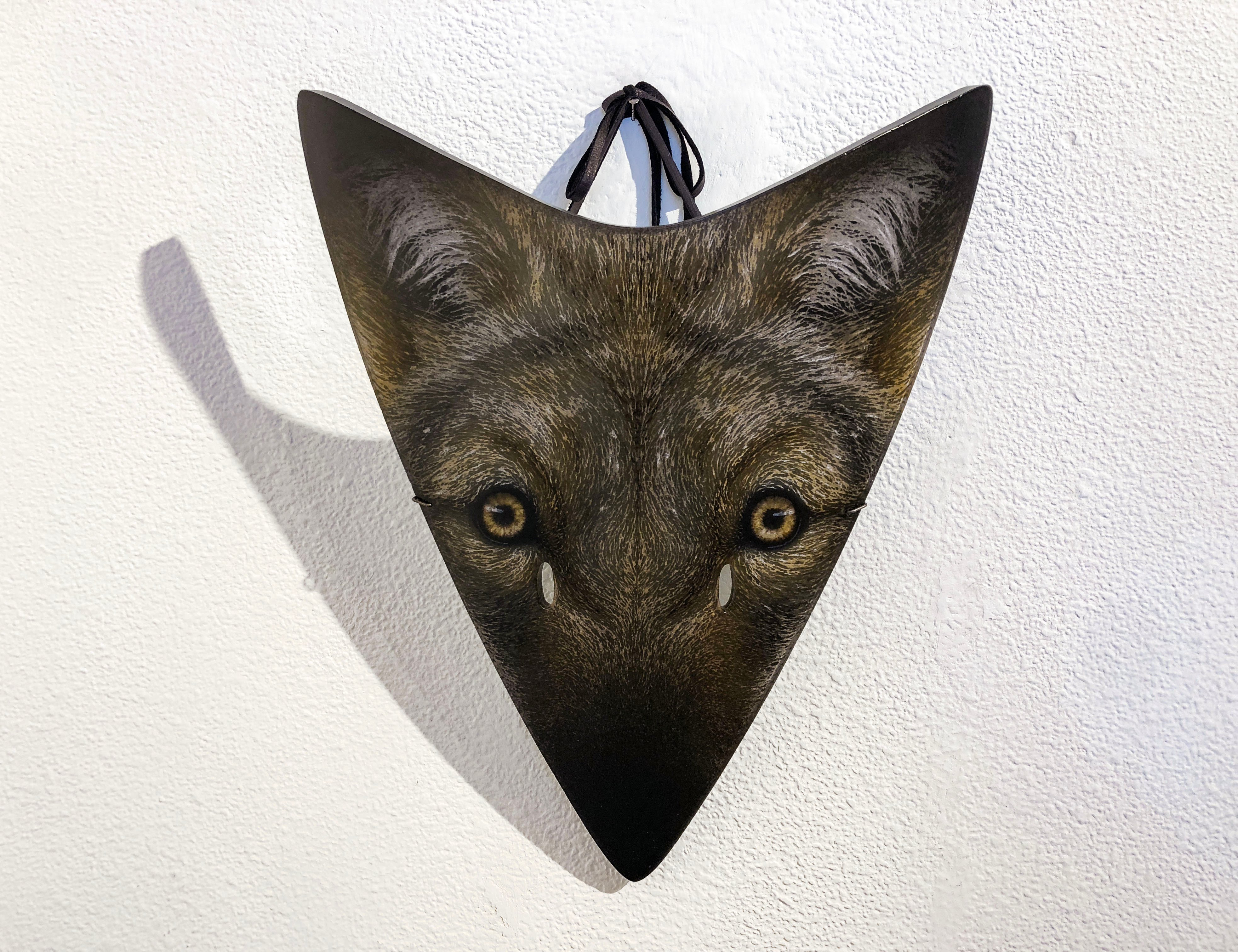 Glass coyote mask by Suzanne Head