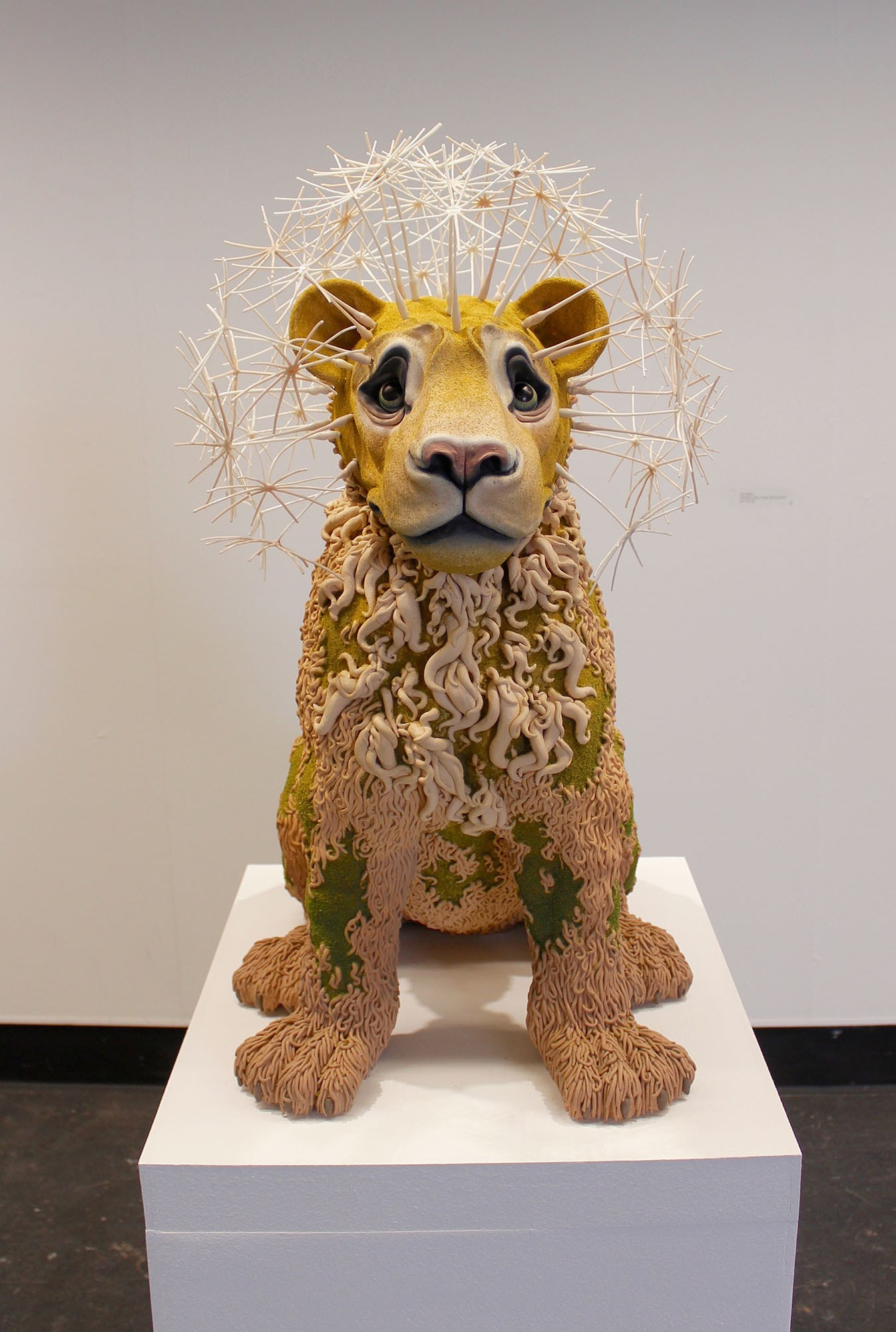 sculpture of a lion by Suzanne Head