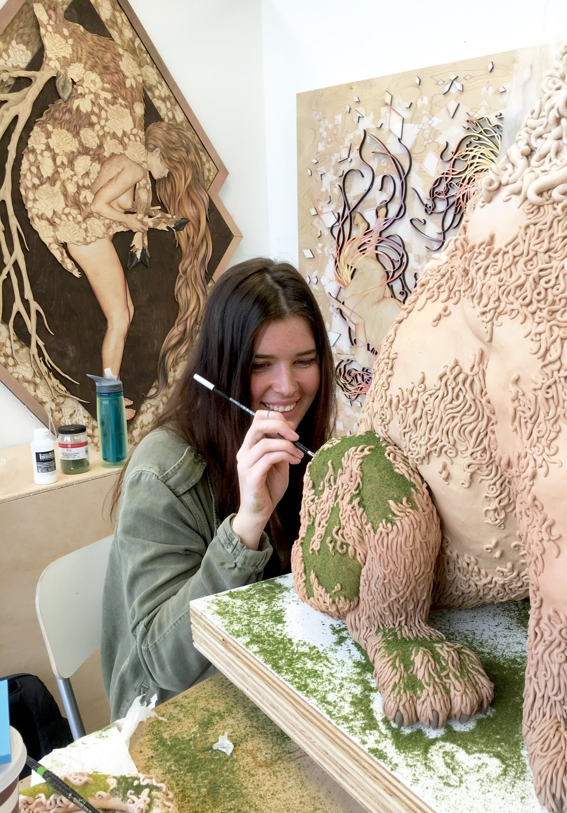 Suzanne Head painting a sculpture of a lion